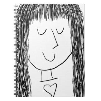 Chica con la franja y un corazón spiral notebooks