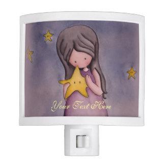 Chica con la luz de la noche de la estrella de Kaw