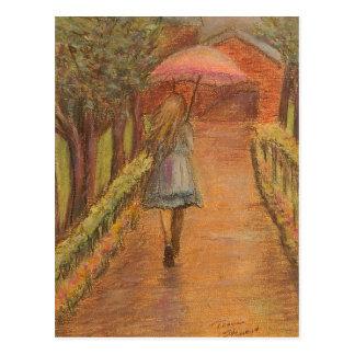 Chica con la postal del paraguas