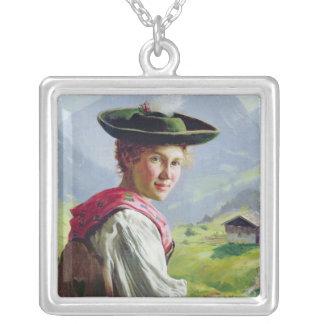 Chica con un gorra en paisaje de la montaña colgante cuadrado