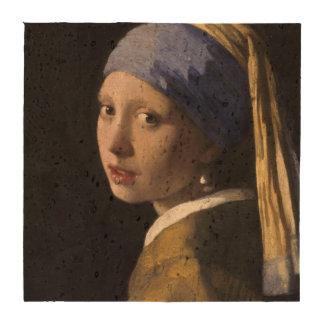 Chica con un pendiente de la perla posavasos