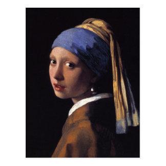 Chica con un pendiente de la perla postales