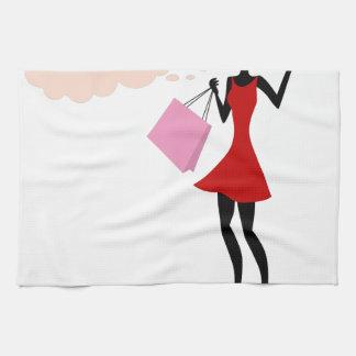 Chica de compras de pensamiento toallas
