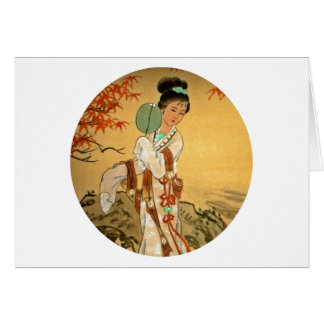 Chica de geisha con la fan tarjeta de felicitación