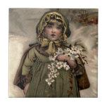 Chica de la nieve del invierno del vintage tejas