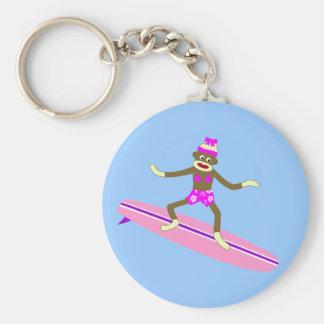 Chica de la persona que practica surf del mono del llaveros
