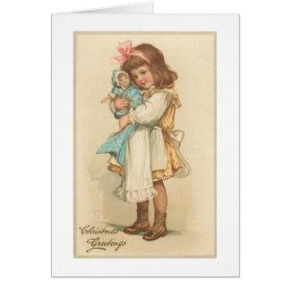 Chica de los saludos del navidad del vintage con l tarjetón