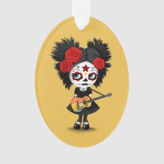 Chica del cráneo del azúcar que toca la guitarra