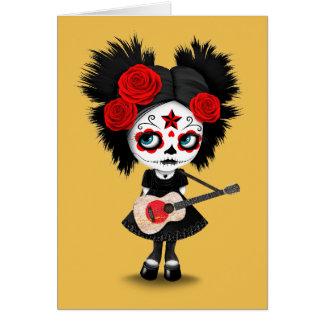 Chica del cráneo del azúcar que toca la guitarra tarjeta pequeña