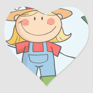 Chica del granjero con un rastrillo en hierba pegatinas de corazon personalizadas
