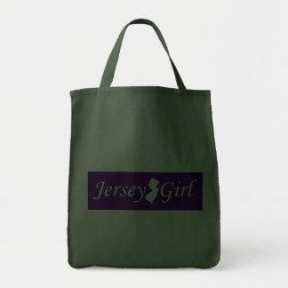 Chica del jersey bolsas