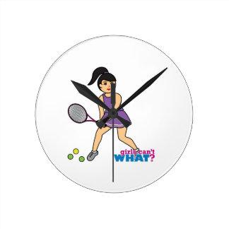 Chica del jugador de tenis - medio reloj
