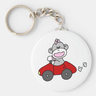 Chica del mono del calcetín en coche rojo llavero personalizado
