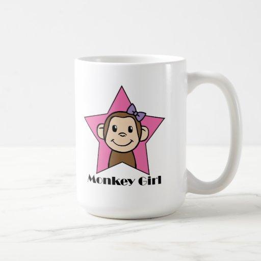 Chica del mono taza de café