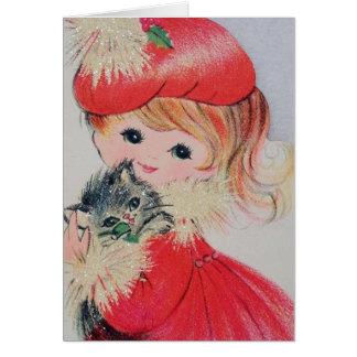 Chica del navidad del vintage que sostiene el tarjeta de felicitación