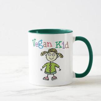 Chica del niño del vegano taza