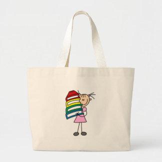 Chica del palillo con los libros bolsa