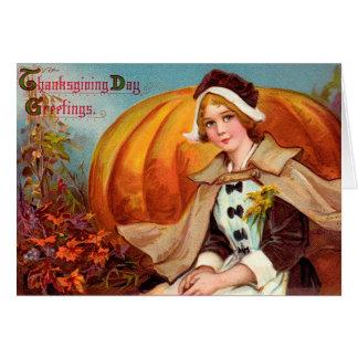 Chica del peregrino de la acción de gracias con la tarjeta pequeña
