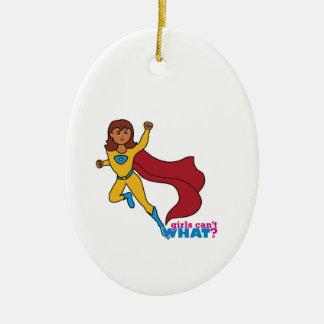 Chica del super héroe adorno navideño ovalado de cerámica