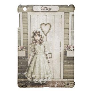 Chica del vintage aseado una cabaña retra