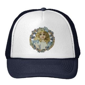 Chica del vintage con el arco y las flores azules gorra