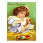 Chica del vintage con el conejito y la tarjeta de  tarjetas postales