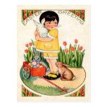 Chica del vintage con los conejitos de pascua y lo postal