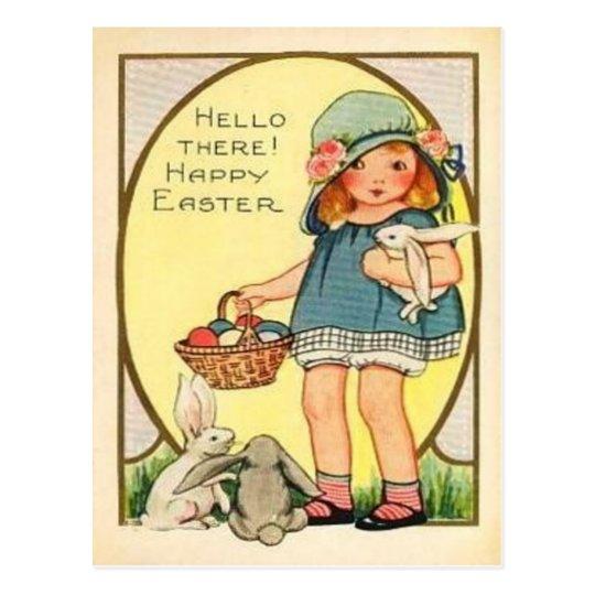Chica del vintage con los conejitos de pascua y tarjeta postal