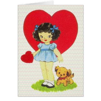 Chica del vintage con una tarjeta del día de San