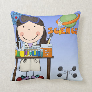 Chica en almohada del laboratorio de ciencia
