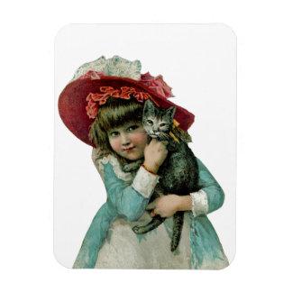 Chica en capo con el gatito del navidad iman rectangular