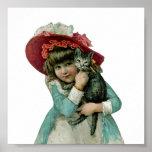 Chica en capo con el gatito del navidad impresiones