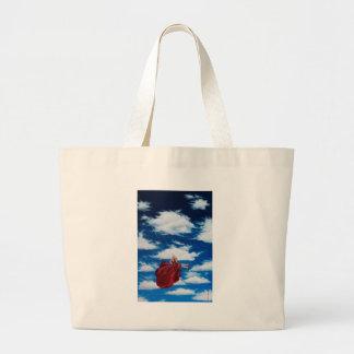 Chica en el oscilación en nubes bolsas de mano