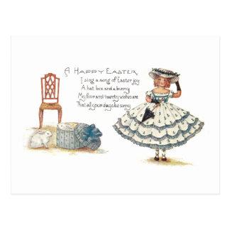Chica en el vestido y los conejitos de Pascua Postales