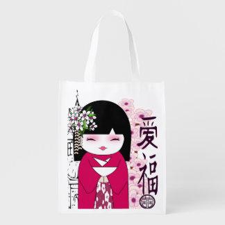 chica japonés lindo. bolso reciclable bolsa de la compra