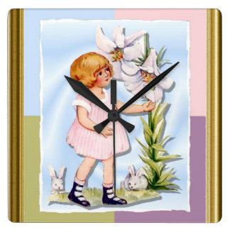 Chica joven con una flor y los conejos reloj de pared