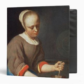 Chica joven con una maja y un mortero