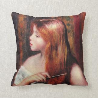 Chica joven de Renoir que peina su almohada del pe
