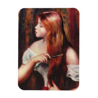Chica joven de Renoir que peina su imán del pelo