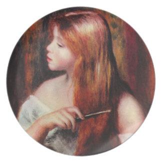 Chica joven de Renoir que peina su placa del pelo Platos