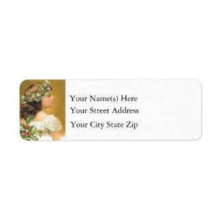 Chica joven del vintage con navidad del acebo etiquetas de remite