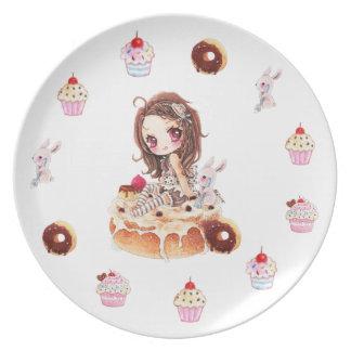 Chica lindo del chibi que se sienta en un bollo de plato de comida