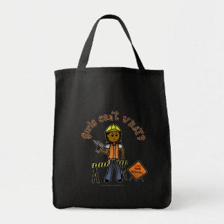 Chica oscuro de la construcción bolsa