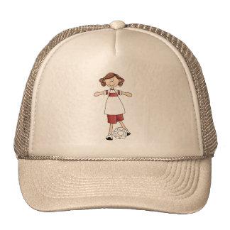 Chica que juega a fútbol gorras