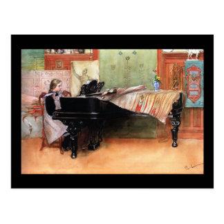 Chica que juega el piano postal