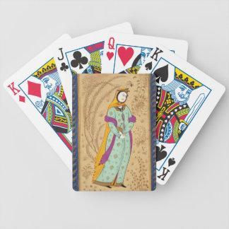Chica que sostiene un buque del vino y una pera, d barajas de cartas