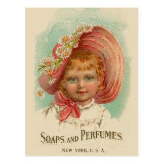 Chica retro de los jabones y de los perfumes de tarjeta postal