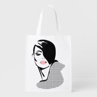 Chica retro elegante de la moda de los puntos bolsas de la compra