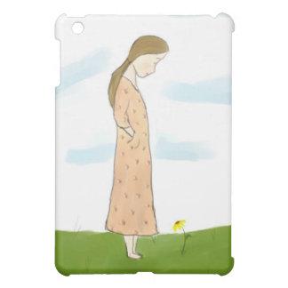 Chica tímido y caja amarilla del iPad de la flor