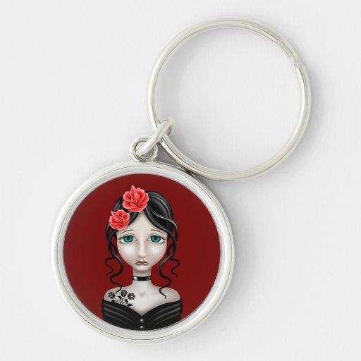Chica triste con los rosas rojos llaveros personalizados